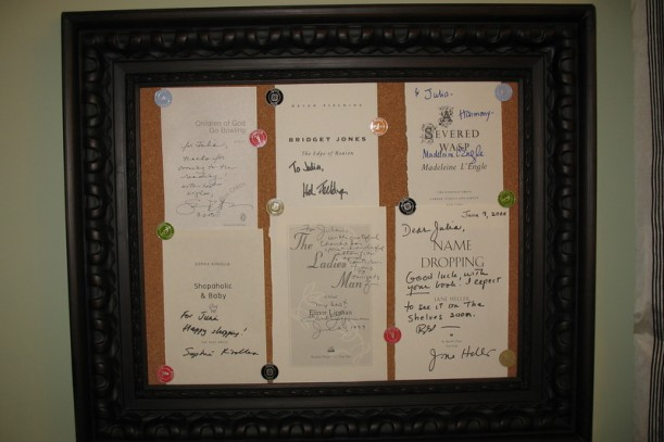 bulletin board with author autographs