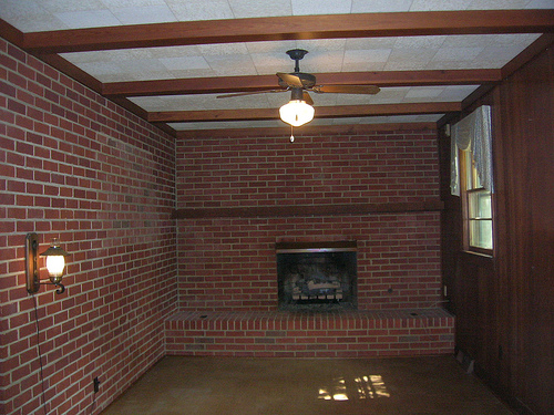 A room with a brick wall