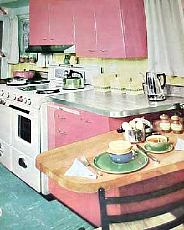 a kitchen with pink cabinets from 1956