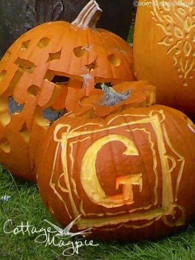 A close up of some monogrammed pumpkins