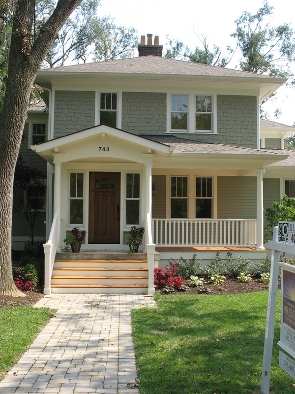 old house with porch and Craftsman style door