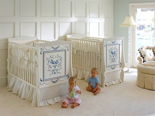 Nursery with two cribs and toddlers on floor