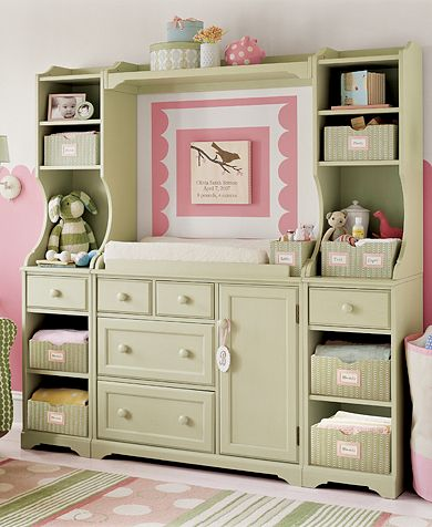 nursery with green changing table