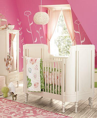 pink nursery with crib