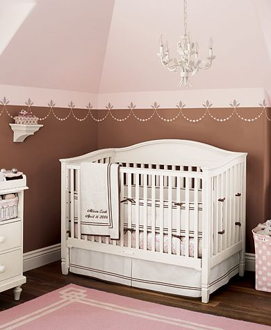 pink and brown nursery with crib
