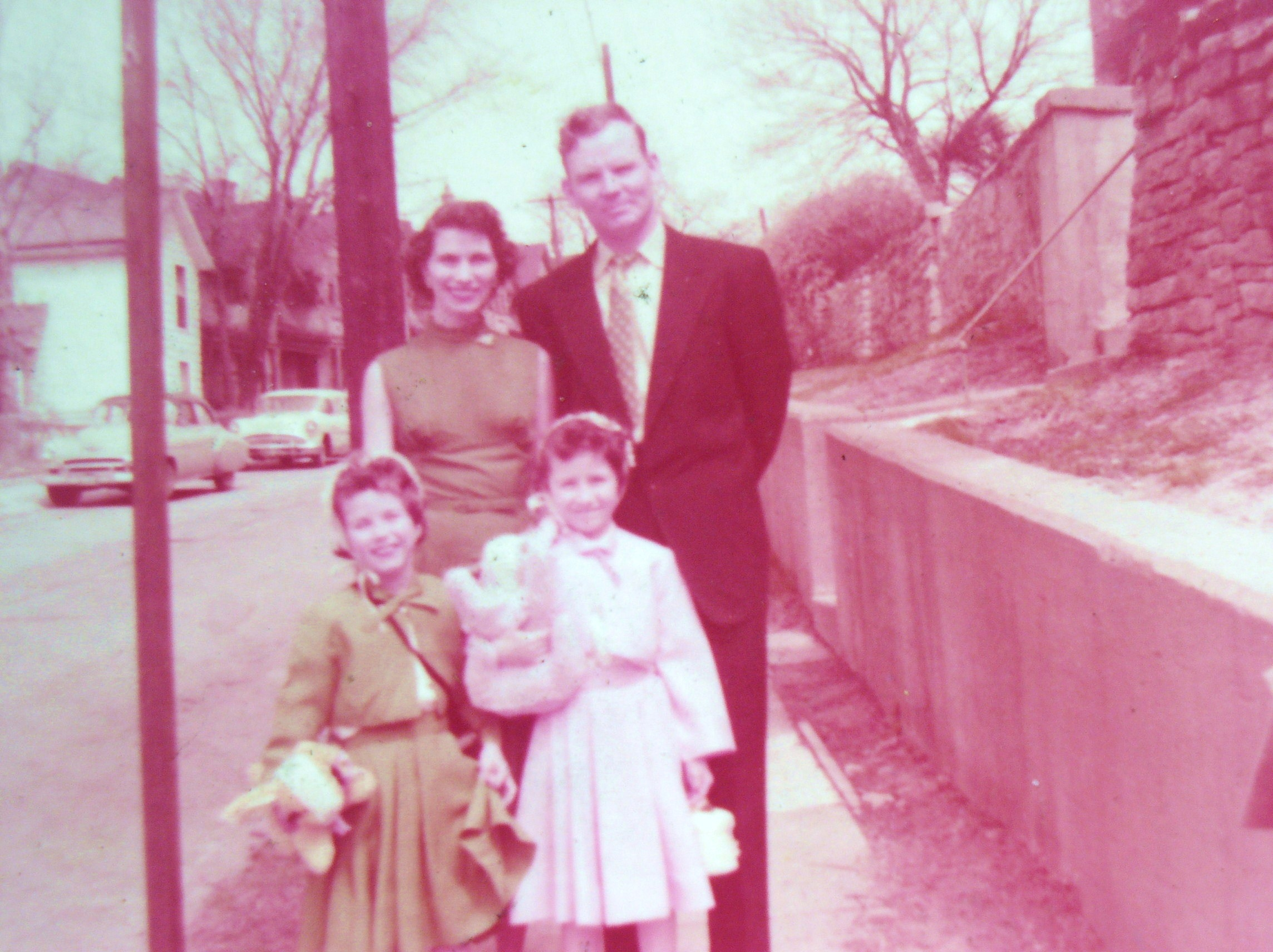 old photo of family in front of house in 1956