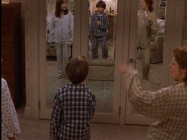 As Ben and Anna lipsync to some Motown music with their mom, you get a glimpse of the mirrored closet doors in her bedroom.
