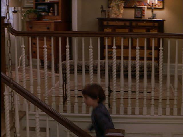 As Ben goes upstairs, we get a glimpse of the upstairs hallway.