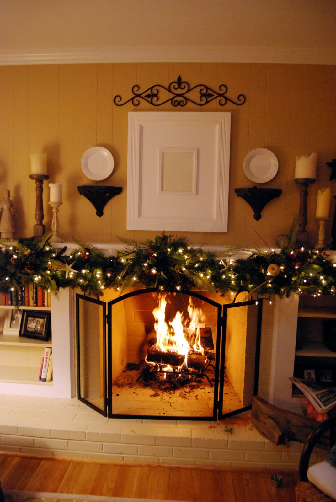 a fireplace with garland on mantel