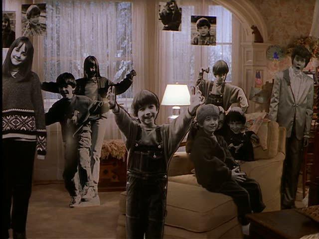 When Jackie returns from the hospital, Isabel surprises her with a room filled with life-sized photographs of her children set. Did anyone else find this a little creepy? No? I guess it's just me... (I did notice the photos were never seen again in the film. Where did Jackie put them all?)