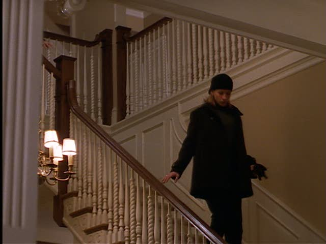 Isabel coming down Jackie's staircase.