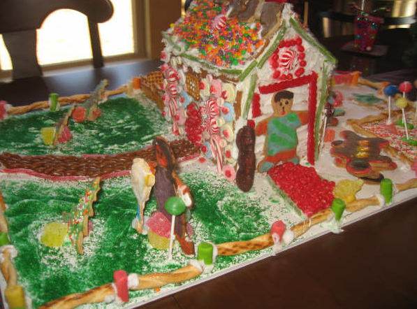 A table with a gingerbread house
