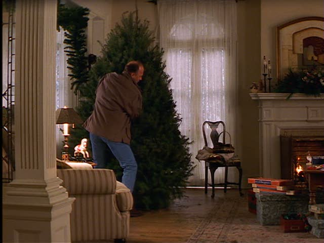 Luke brings Jackie a Christmas tree.