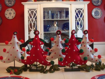 A group of stuffed christmas trees on dining table