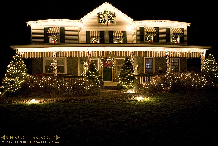 exterior of two story house decorated for Christmas