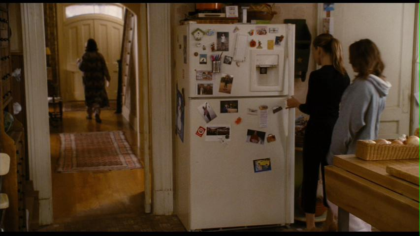 The set designer says she carefully chose every magnet and photo for the fridge to make it look like a real family lived there.