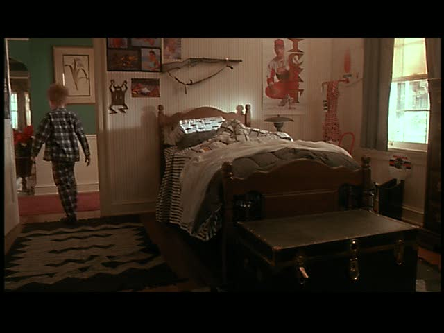 Kevin's brother's bedroom. That gun on the wall's gonna come in handy!