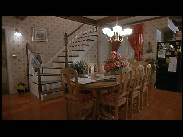 Does anyone else fantasize about having a back staircase that comes down into the kitchen like this, or is it just me?