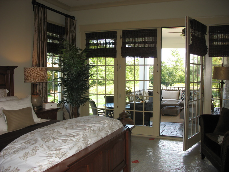 French doors lead from the master bedroom onto a covered porch.