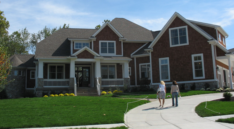 front exterior of shingle style house in home show