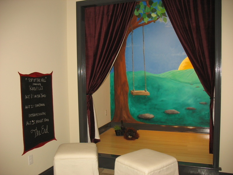 A cute little theater set up for children to play in.