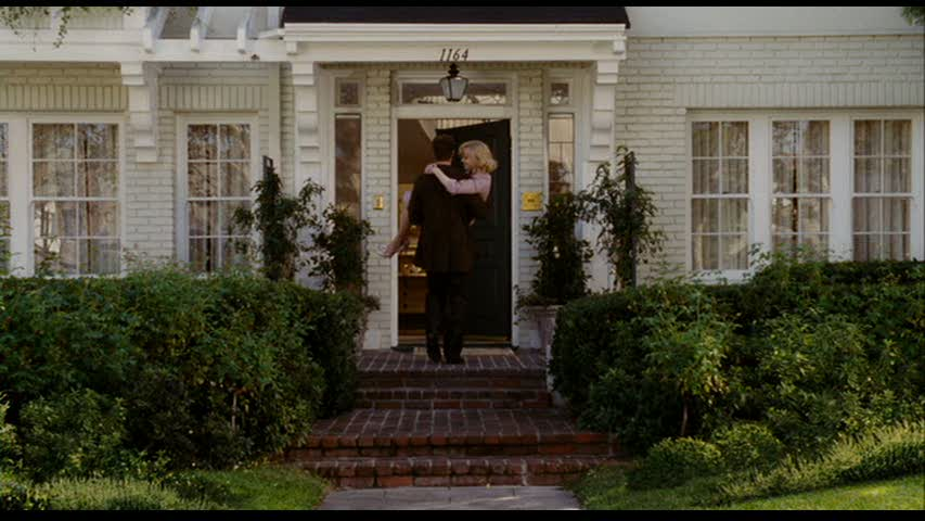 Nicole Kidman being carried over threshold of new house in Bewitched