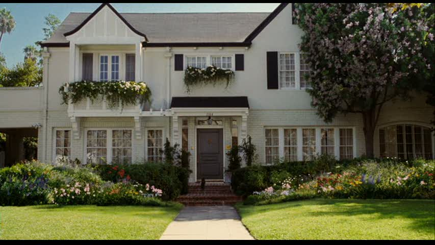 house at the end of the movie Bewitched with shutters and flower boxes