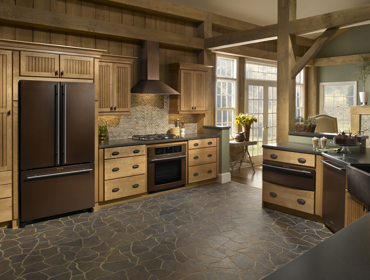 A large kitchen with bronze appliances