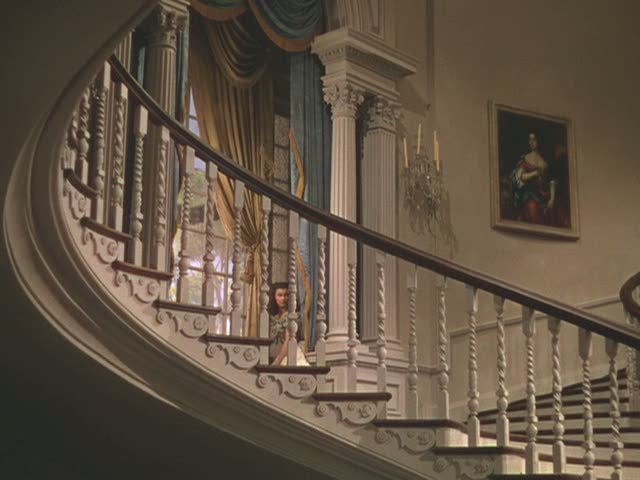 Scarlett coming down the staircase in Twelve Oaks