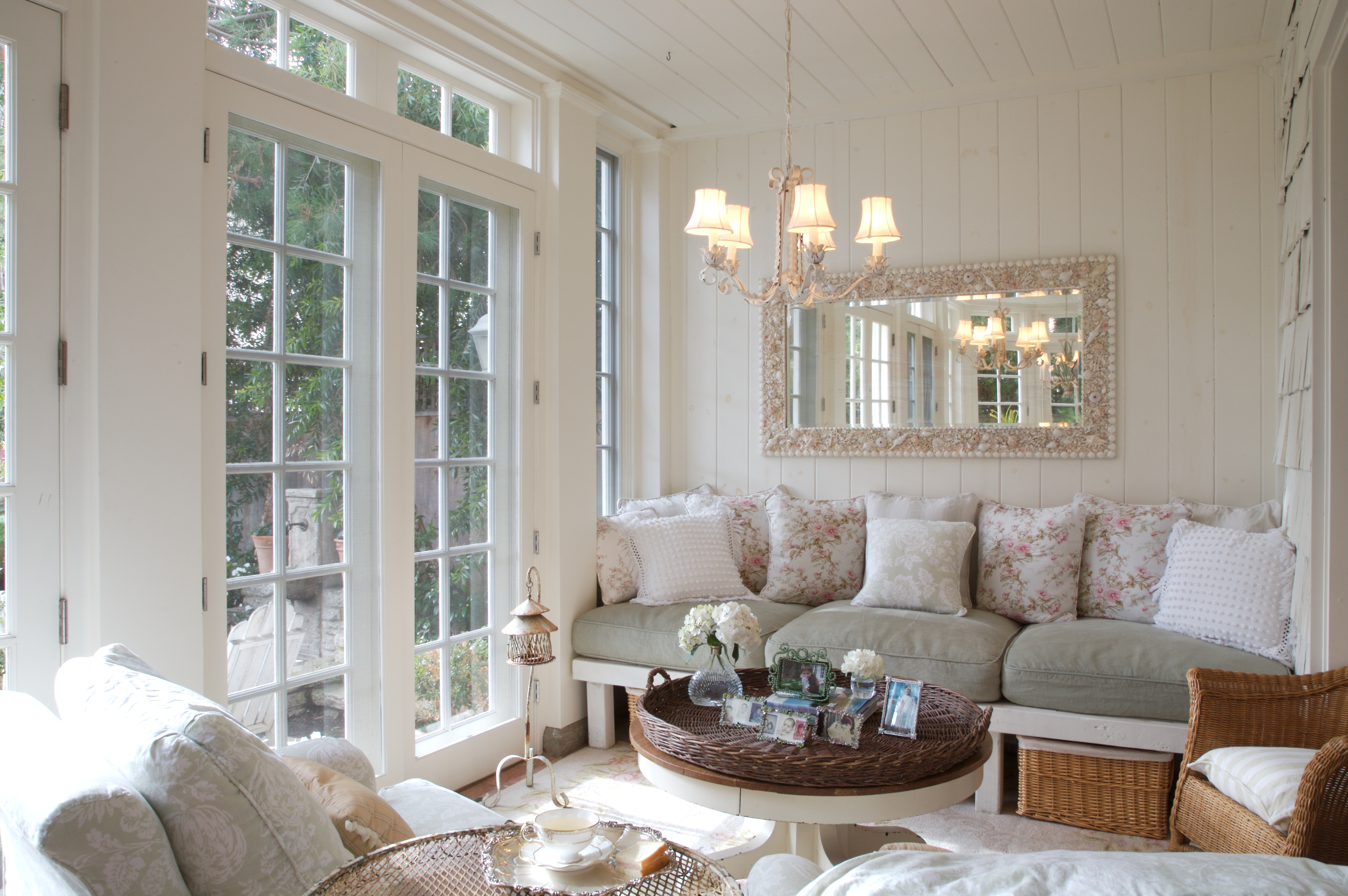 screened porch with sofa