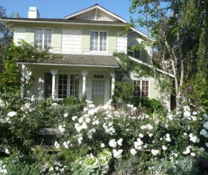 front exterior of Brooke's beach house with rose garden
