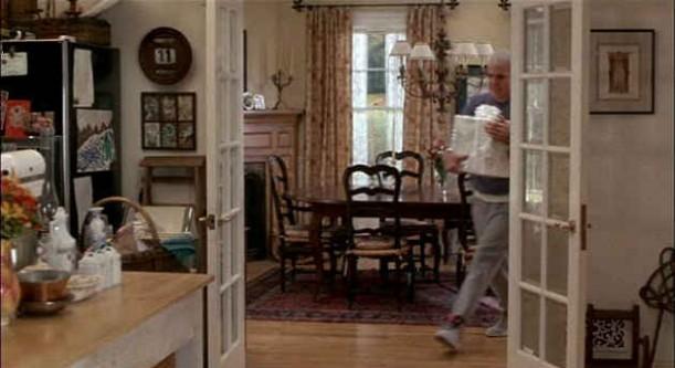 Steve Martin walking through dining room