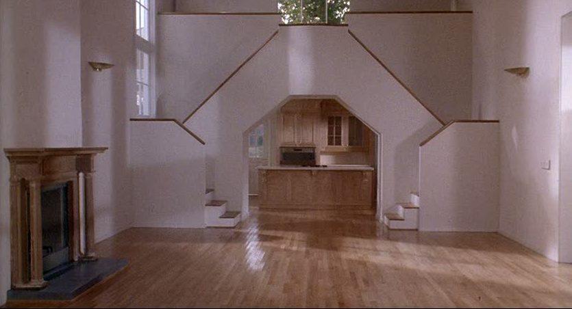 empty living room looking toward kitchen