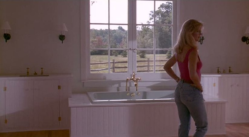 Goldie Hawn in bathroom with tub open to bedroom