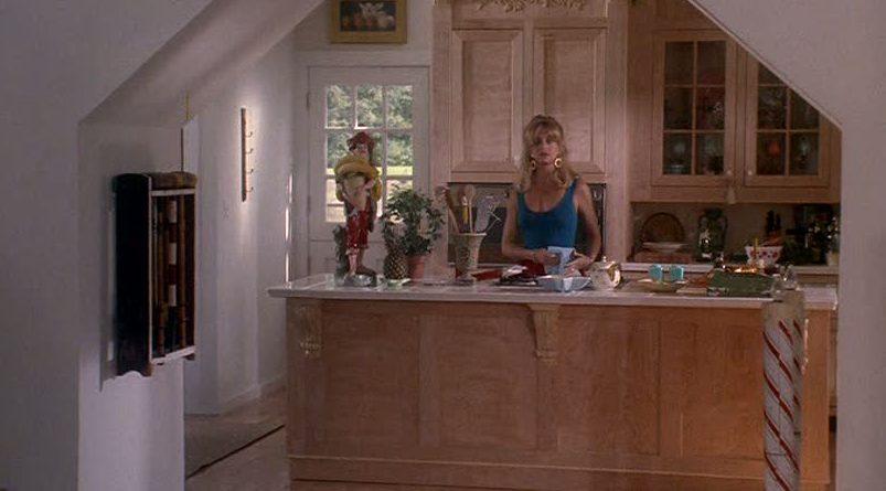 Goldie Hawn standing in kitchen at island