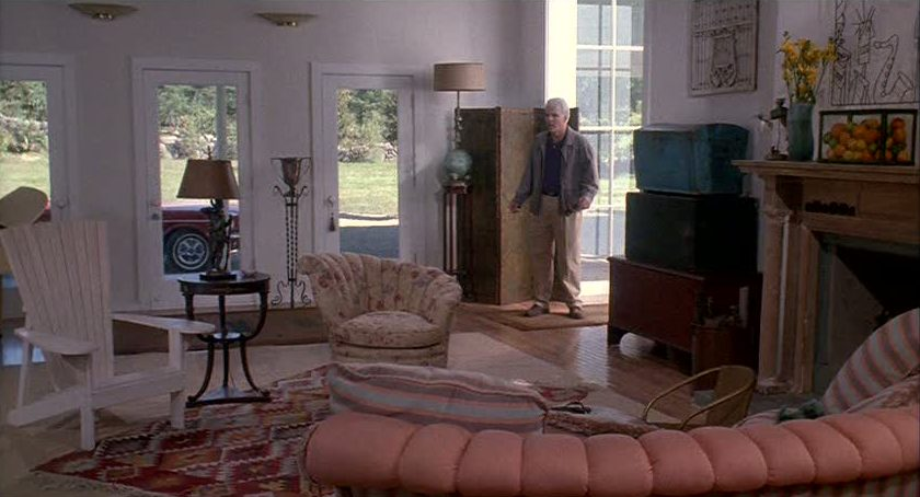 Steve Martin in living room filled with furniture
