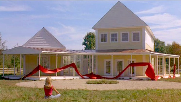 Housesitter movie yellow house red ribbon
