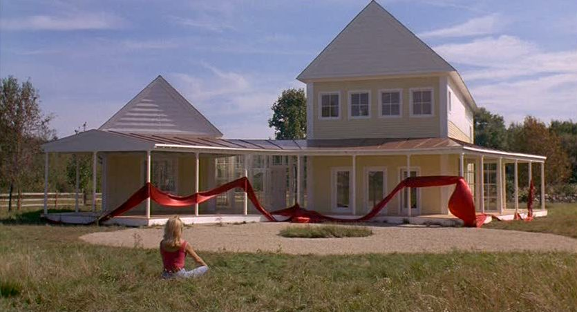 Housesitter movie yellow house with red ribbon