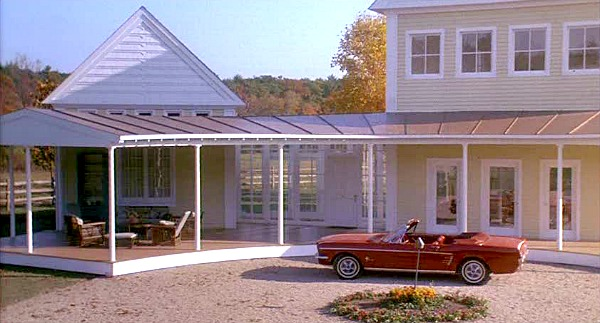 Steve Martin's red convertible outside yellow house
