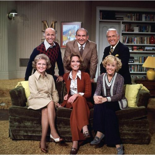 the cast of the Mary Tyler Moore Show in the living room of her apartment