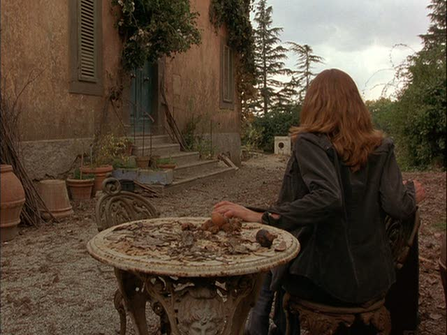 Diane Lane sitting outside the villa surveying the work to be done