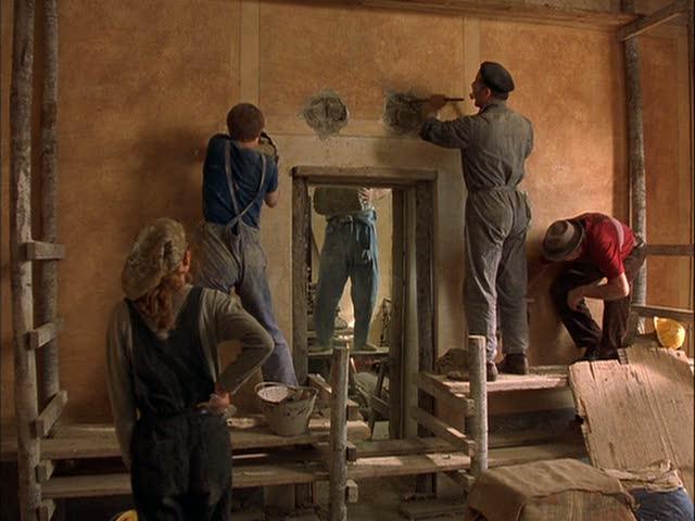 workers restoring the villa