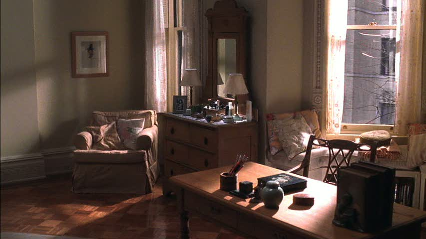 A bedroom filled with furniture and a large window