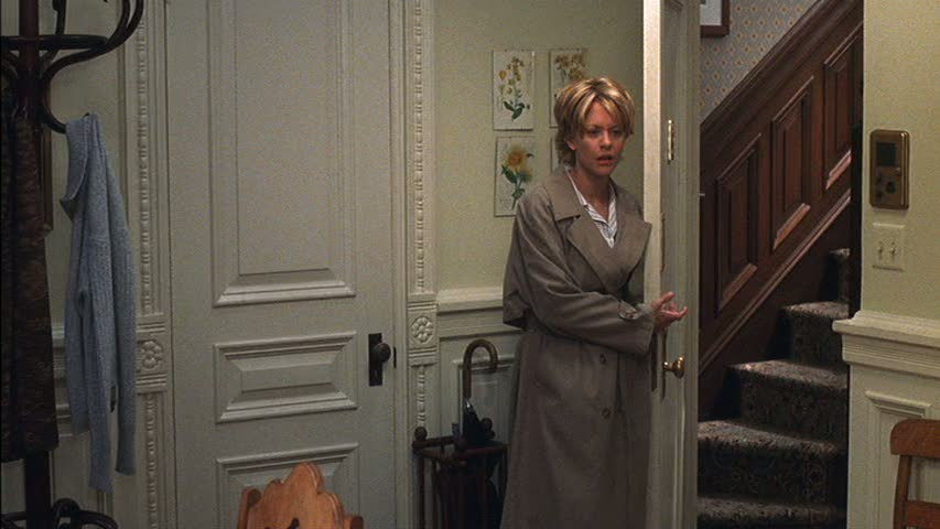 Meg Ryan standing in open doorway of apartment