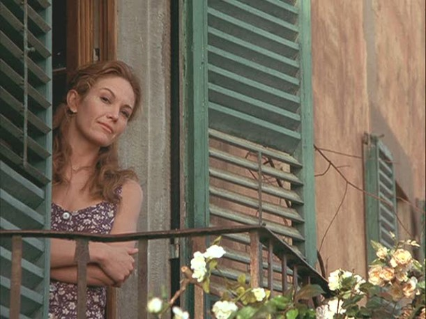 Diane Lane standing in open doorway looking outside