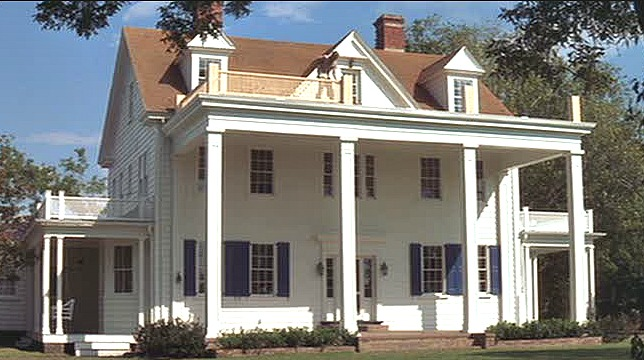 Noah\'s white house with blue shutters