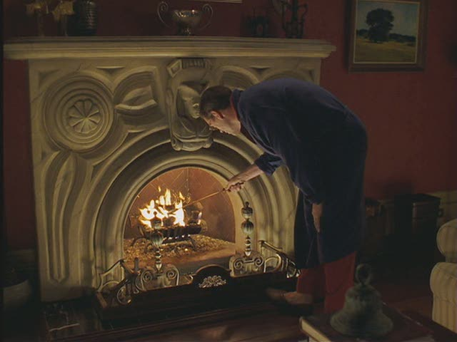A man standing in front of a fireplace in Stuart Little