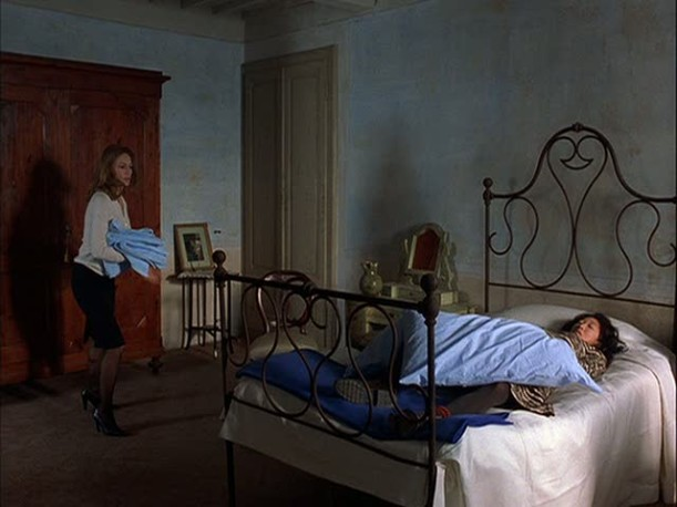 Sandra Oh in blue bedroom