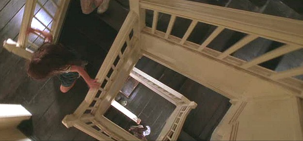 looking down staircase in Practical Magic house
