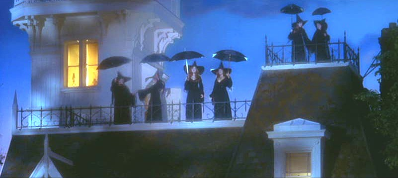 witches on the roof with umbrellas practical magic